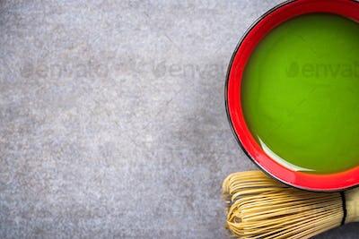 Green Matcha tea prepared in bowl