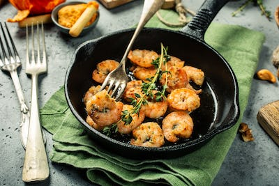 Shrimps roasted on frying cast iron pan