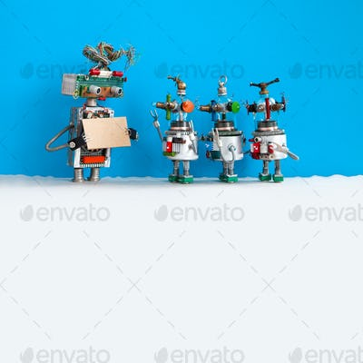 Robot with a cardboard mockup and three funny robotic toys