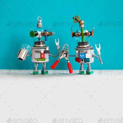 Maintenance repair service concept. Two comical electrician robots are ready for maintenance.