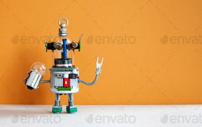 Funny robotic toy holds light bulb.