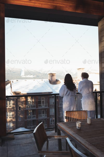 Rear view of couple looking at view from balcony