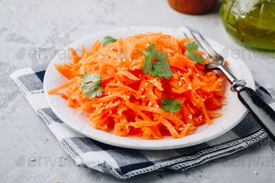 Fresh healthy grated carrot salad in bowl