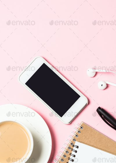 Female home office  workplace with notepad, coffee cup, succulent and mouse on pink