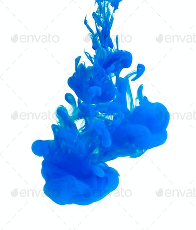 Blue acrylic color in water, abstract background.