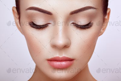 Beautiful woman with long false eyelashes