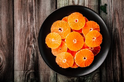 Raw fresh Citrus Salad with Oranges on wooden background