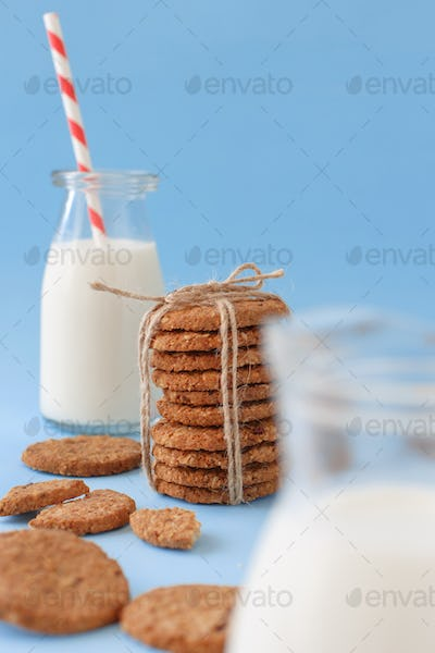 Milk and cookies on a blue background