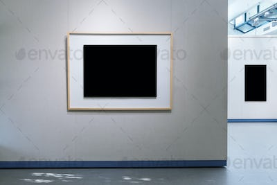 blank picture frames on exhibition wall with clipping path