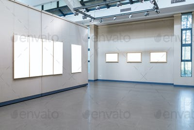 blank picture frames with clipping path on exhibition wall in a room