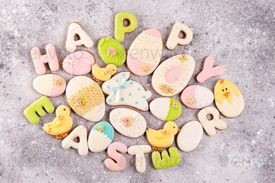 Happy Easter colorful lettering Happy Easter of ginger biscuits and cookies bunny on stone