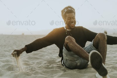 Man sitting at the beach