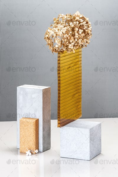 Still life using concrete blocks, textural building elements and