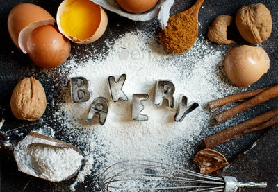 Ingredients and utensils for baking with word Bakery