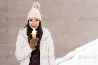 Beautiful young asian woman smile and happy with ice cream in sn
