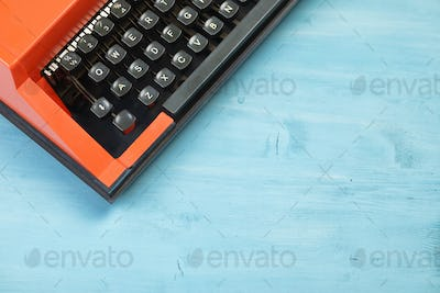 Red typewriter keyboard with blue space for text