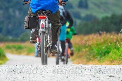 Cyclists on a group trip in nature in the mountains