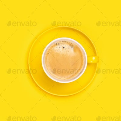 Yellow coffee cup on yellow background, flat lay