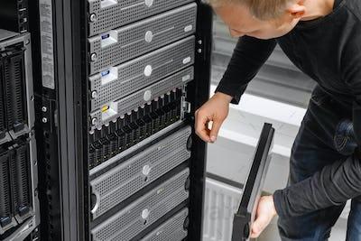 Male IT Consultant Examining SAN At Datacenter