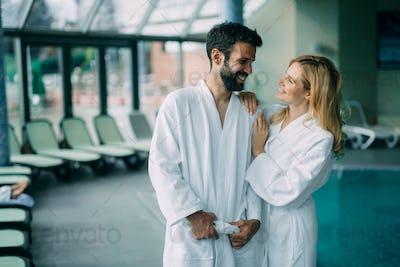 Portrait of attractive couple in spa center