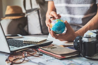 Young traveler planning vacation trip and searching information