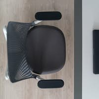 Top view modern laptop on an office table and orthopaedic chair - well designed work space