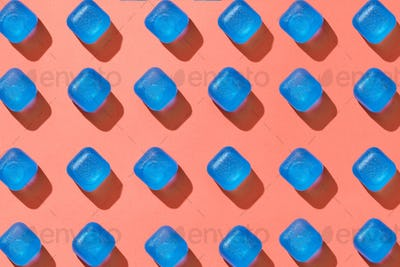 Ceometrical pattern from blue plastic cubes with shadows on a background in a color of the year 2019