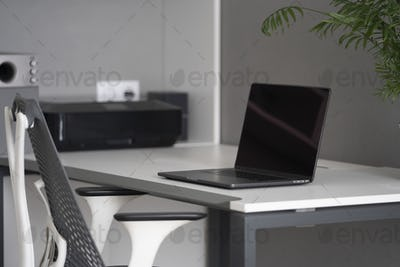 Home office with up-to-date equipment for a comfortable work. New modern notebook, up-to-date