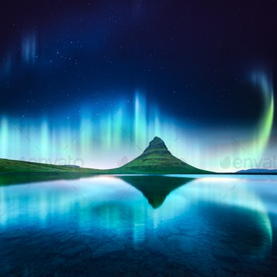 Green aurora light behind kirkjufell mountain