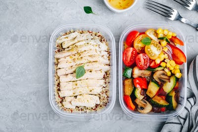 Meal prep containers with quinoa, grilled and fresh vegetables and chicken