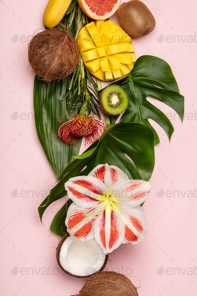 Creative flat lay with tropical fruits and plants
