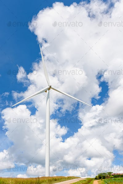 Windmill on sky background