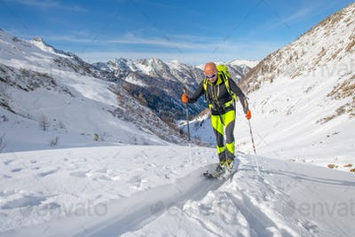 Uphill during a solitary ski touring trip