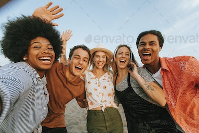 Group of diverse friends taking a selfie at the beach