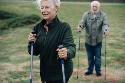 Active seniors with trekking poles