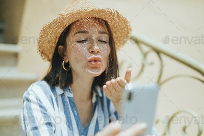 Woman making a video call from her phone