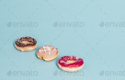 Three donuts on blue