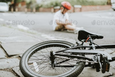 Young boy knocked off his bike