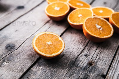 fresh, oranges on a wooden background