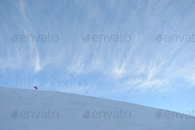 Extreme Snowboarder Hiking On A Windy Mountain Ridge In Snowy Winter