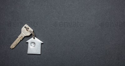 House key on black color background, copy space