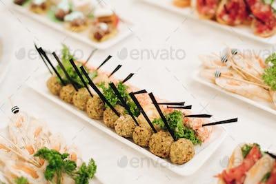 Several snacks served on birthday party or wedding celebration