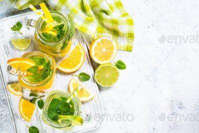 Lemonade, mojito and orange lemonade on white
