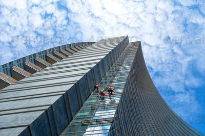Group of Alpinists in service for windows cleaning of skyscraper