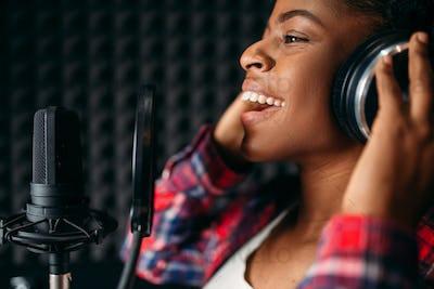 Female singer songs in audio recording studio
