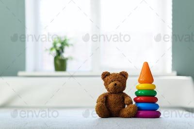 Plush teddy bear toy on white bed