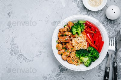 Teriyaki Chicken buddha bowl lunch with rice, broccoli and red bell pepper