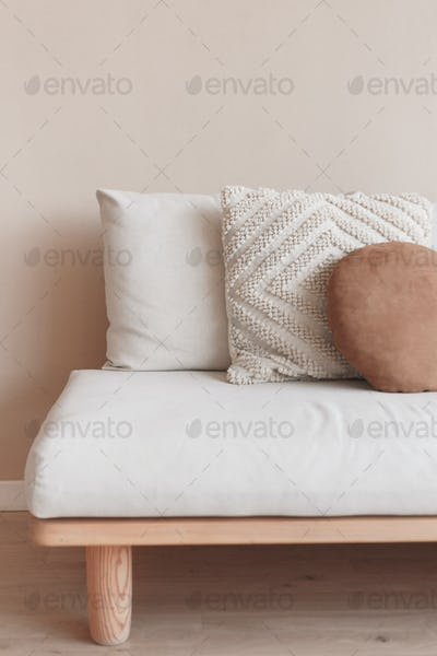 White square pillow on white sofa