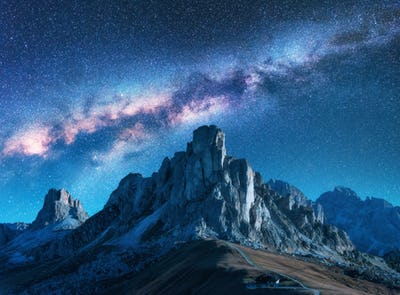 Starry sky with Milky Way above mountains at night in summer.