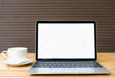 Coffee cup with laptop mockup on wood_